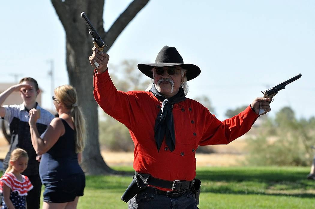 Horace Langford Jr./Pahrump Valley Times- 4th of July parade, Pahrump Gunfighters Dan Delgado performs