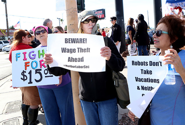 Bizuayeh Tesfaye/Las Vegas Review-Journal Residents and workers join a minimum-wage protest outside a fast-food restaurant in Las Vegas.