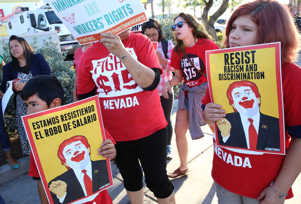 Angel Guzman, left, and his sister Zoe, 13, join McDonald's employees to protest for a higher minimum wage outside of a McDonald's on 2650 W. Sahara Ave., May 24, 2017, in Las Vegas. (Bizuayehu Te ...