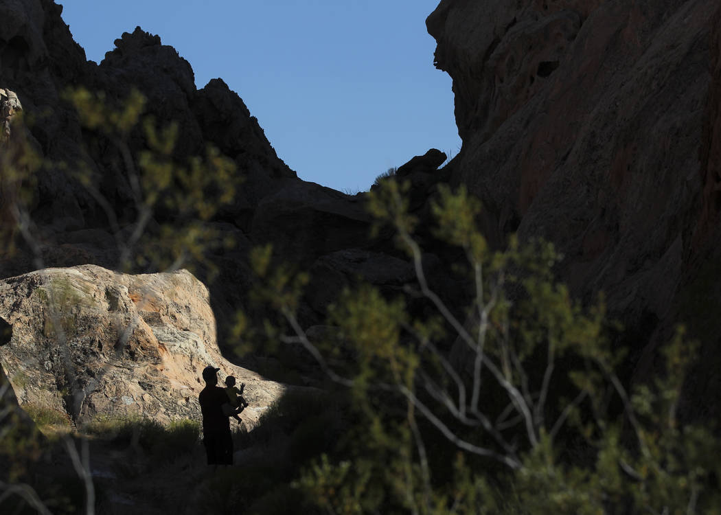 David Richards with his 9-month-old son, Phoenix, in the Whitney Pockets area of the Gold Butte National Monument south of Bunkerville on Friday, June 2, 2017. (Chase Stevens/Las Vegas Review-Jour ...