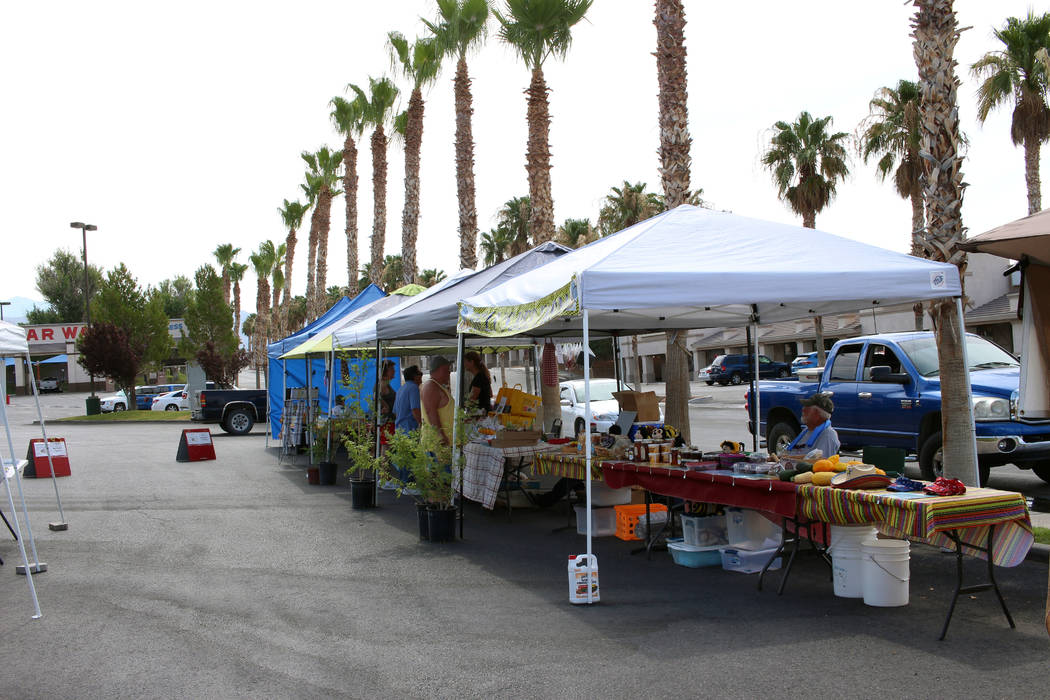 Jeffrey Meehan/Pahrump Valley Times Vendors with fresh produce and other items set up at Farmer's Market held in Draft Picks' parking lot on July 8, 2017.