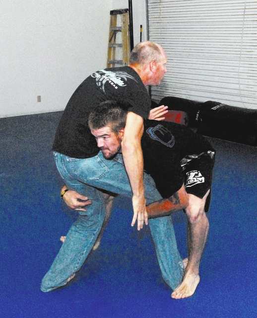 Horace Langford Jr. / Pahrump Valley Times - Above: MMA Fighter Brandon Schneider sparring with coach Brian Thelaner (right). Thelaner coaches jiu-Jitsu and kickboxing.