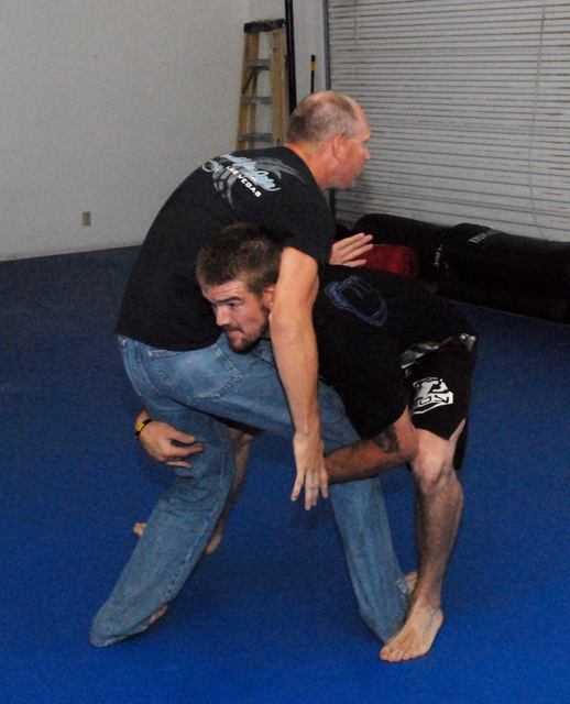 Horace Langford Jr. / Pahrump Valley Times MMA fighter Brandon Schneider trains with coach Brian Thelaner. The fighter returns to the ring in two weeks in Mesquite. The fighter is battling a longt ...