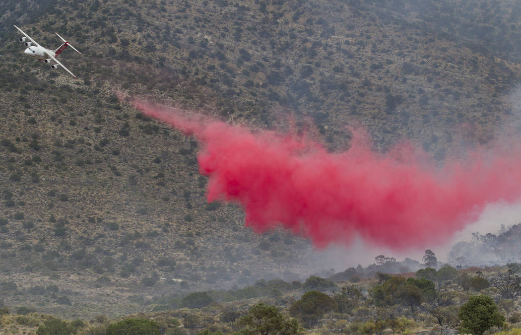An air tanker drops a load of fire retardant while fighting a wildfire burning on the Pahrump side of Mount Potosi southwest of Las Vegas on Friday, July 7, 2017. (Richard Brian/Las Vegas Review-J ...