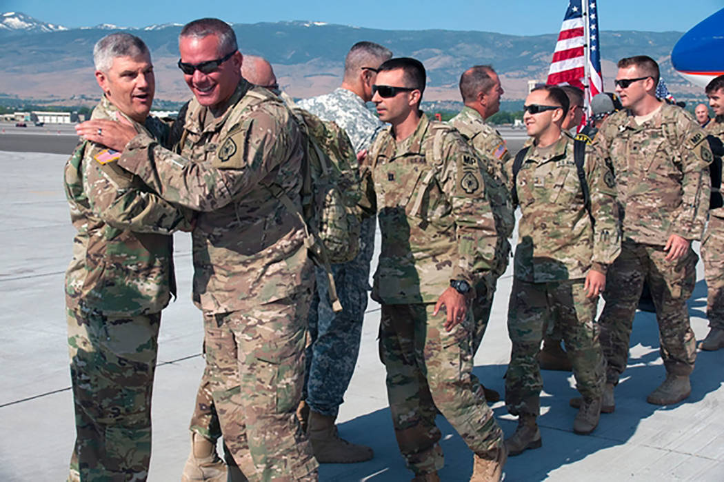Tech Sgt. Emerson Marcus, Nevada National Guard State Historian Col. Eric Wishart, left, greets 485th Military Police Company Soldiers led by 1st Sgt. Elbie Doege upon their arrival at Atlantic Av ...