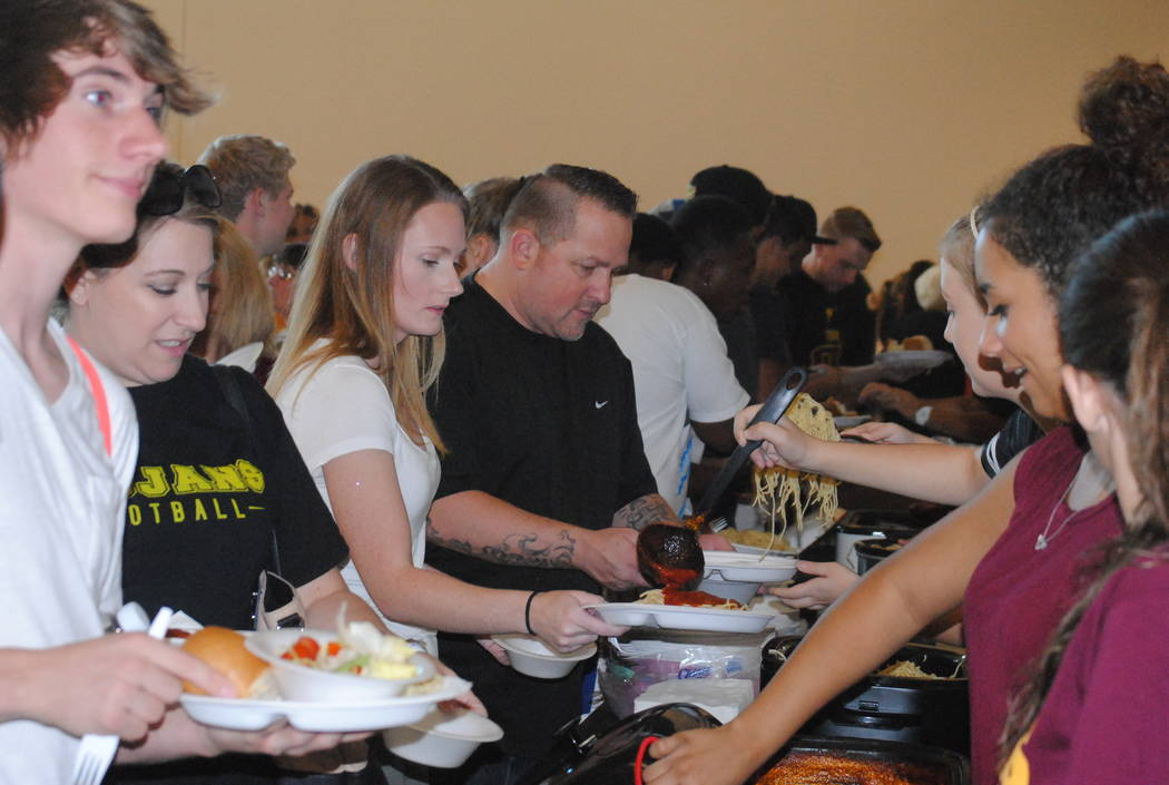 Charlotte Uyeno/Pahrump Valley Times Trojans football supporters in line for spaghetti at last year's event. The Trojans said over 200 people came and were fed.