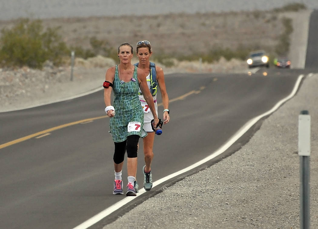 Badwater Hall of Famer Lisa Smith-Batchen runs up the hill going into Stovepipe Wells. She was attempting her 10th finish and made it. She said this was her last Badwater run.