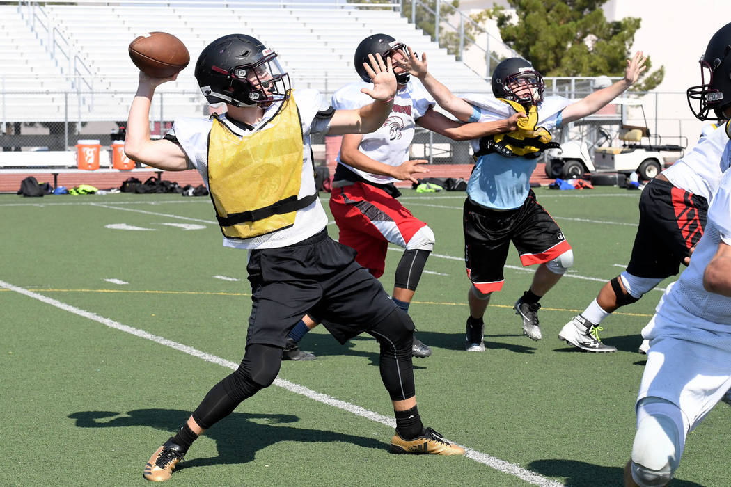 Peter Davis/Special to the Pahrump Valley Times Senior quarterback Dylan Coffman fires off the ball during practice last week. Trojans coach Joe Clayton says Coffman will be over center this year.