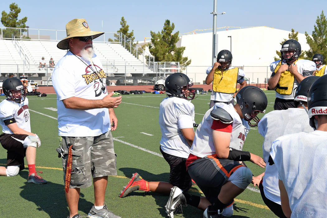 Peter Davis/Special to the Pahrump Valley Times  Fred Schmidt pushing his linemen during last week's Trojans camp. Schmidt has been with Clayton, along with most of the other coaches, for more t ...