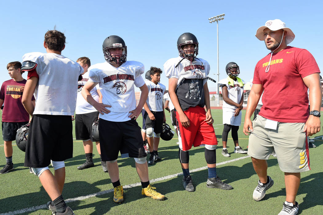Peter Davis/Special to the Pahrump Valley Times At last week's Trojans football camp, Trojans coach Mike Colucci has a coachable moment with some of the football players. The Trojans are at the  ...