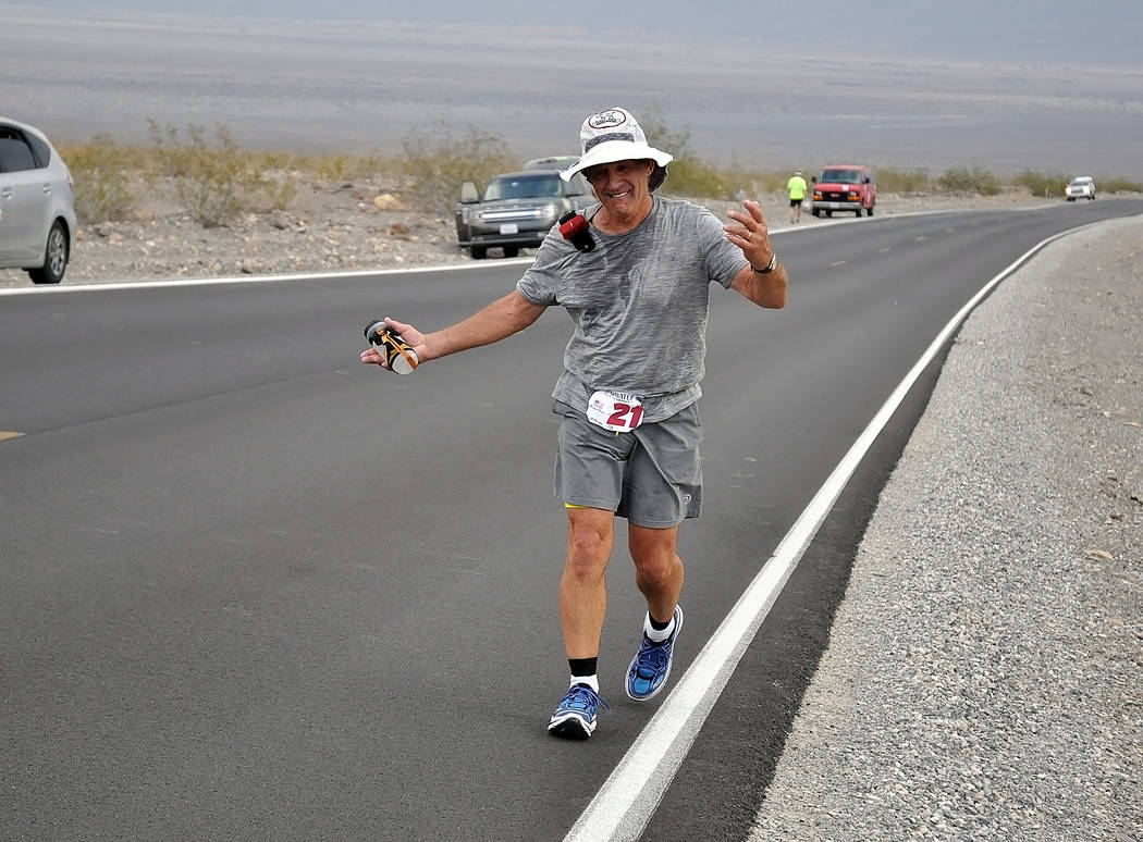 Horace Langford Jr./Pahrump Valley Times - Four-time champion, Marshall Ulrich runs with his HOKAs during the last STYR Labs Badwater 135 in Death Valley.