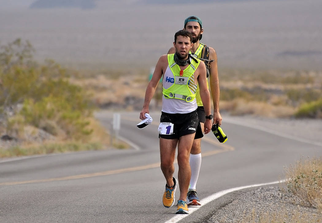 Horace Langford Jr./Pahrump Valley Times -Pete Kostelnick (No. 1) shows off his HOKA shoes as he runs the The STYR Labs Badwater 135 earlier this month. Kostelnick is a two-time champion of the ra ...