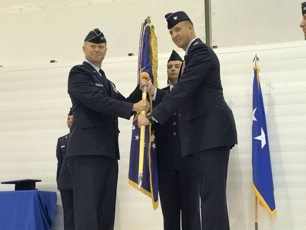 Air Force Lt. Gen. Mark Kelly, left, with Col. Julian Cheater Thursday, July 6, 2017, during a change-of-command ceremony inside the Reaper hangar at Creech Air Force Base, Indian Springs, Nevada. ...