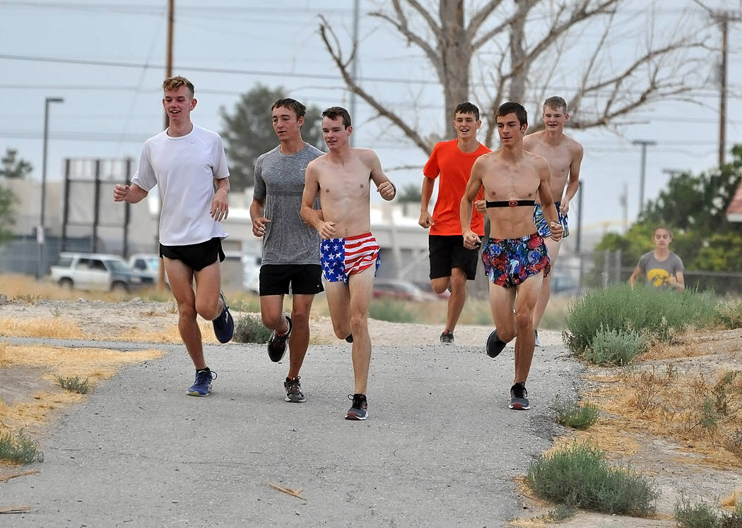 Horace Langford Jr./Pahrump Valley Times  Cross-country team runs through Discovery Park on Wednesday morning, getting in a couple of miles. In front are from left to right, Layron Sonerholm, Cole ...