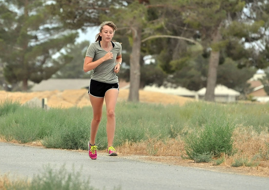 Horace Langford Jr./Pahrump Valley Times  Junior Katherine Goodman runs through Discovery Park for a morning jog with the boys cross-country team. She and Grace Plumb have been hoping more girls w ...