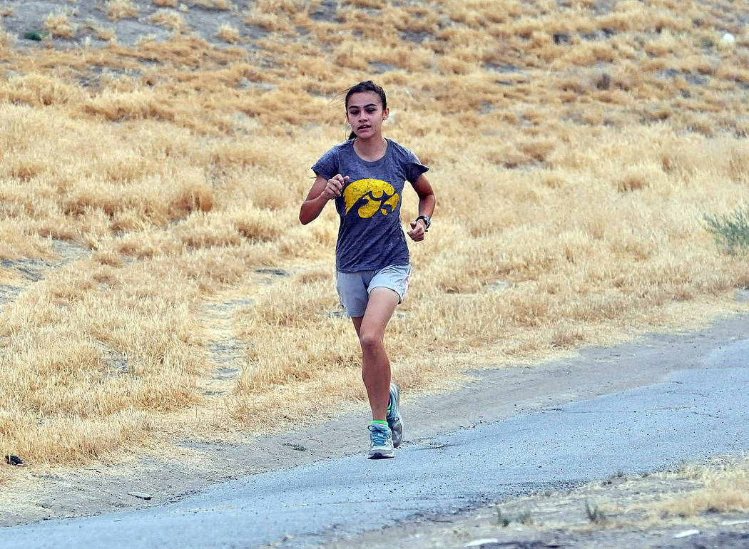 Horace Langford Jr./Pahrump Valley Times  Senior Grace Plumb runs through Discovery Park with the boys to get in shape for the up-coming season.