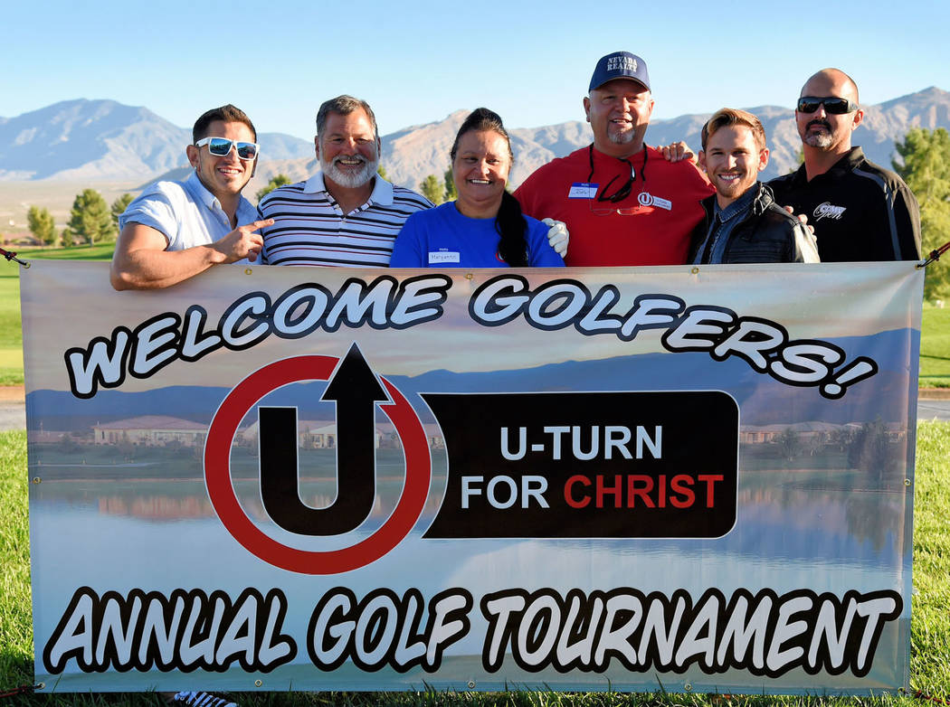 Peter Davis / Special to the Pahrump Valley Times  At last year's tournament, U-Turn for Christ golfers hold up the tournament sign. The founder of U-Turn for Christ is in the striped shirt; nex ...