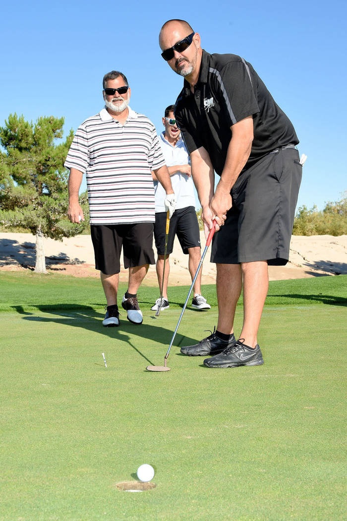 Peter Davis/Special to the Pahrump Valley Times Pastor Jerry Brown, founder of U-Turn for Christ (striped shirt) watches a teammate make his putt last year.