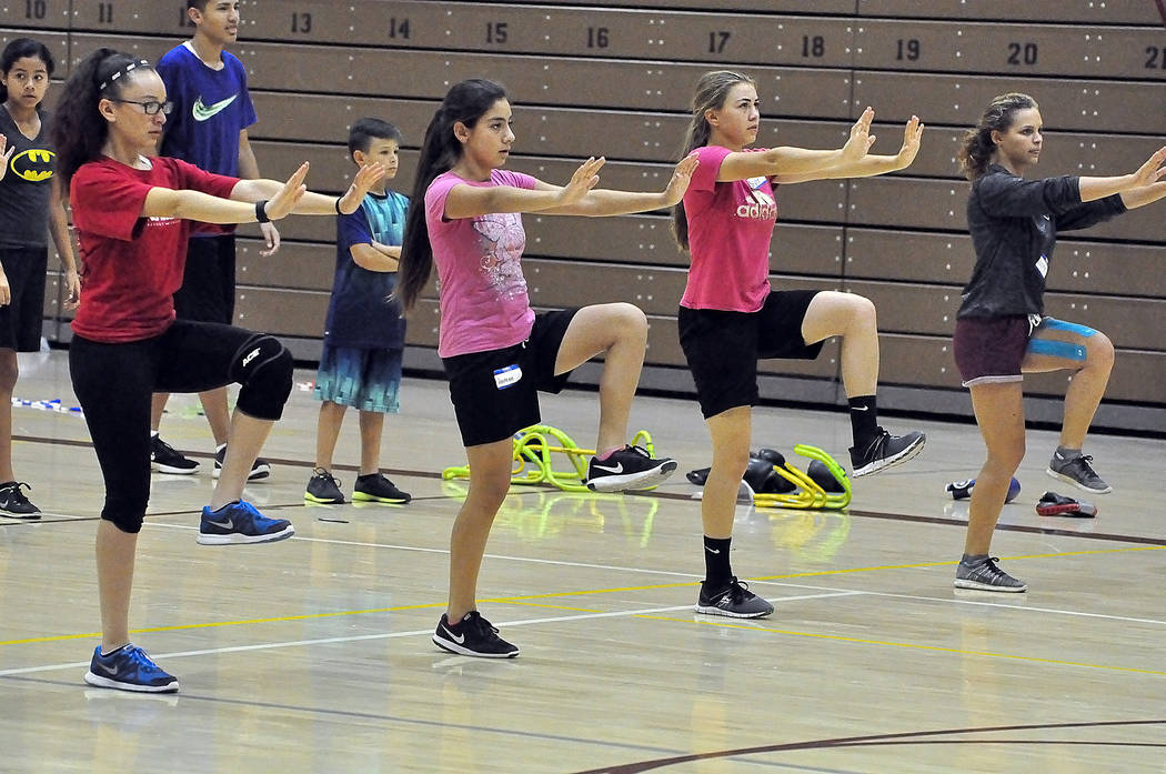 Skylar Lauvar, third from the left, shows the girls how it's done at the Youth Sports Clinic on Monday. The clinic was in town this week at the Pahrump Valley High School gym. The clinic was for ...