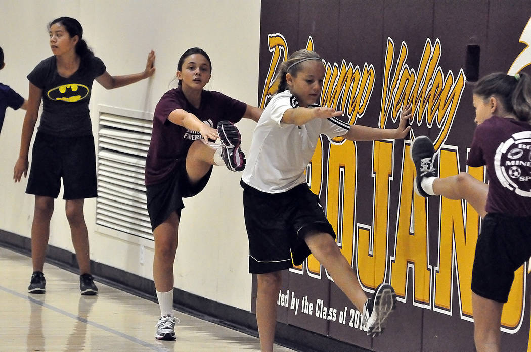 Horace Langford Jr./Pahrump Valley Times Emily Lewis, second from the left, listens intently to Dominique Maloy's instructions. Maloy definitely has the patience and motivational skills to coach ...