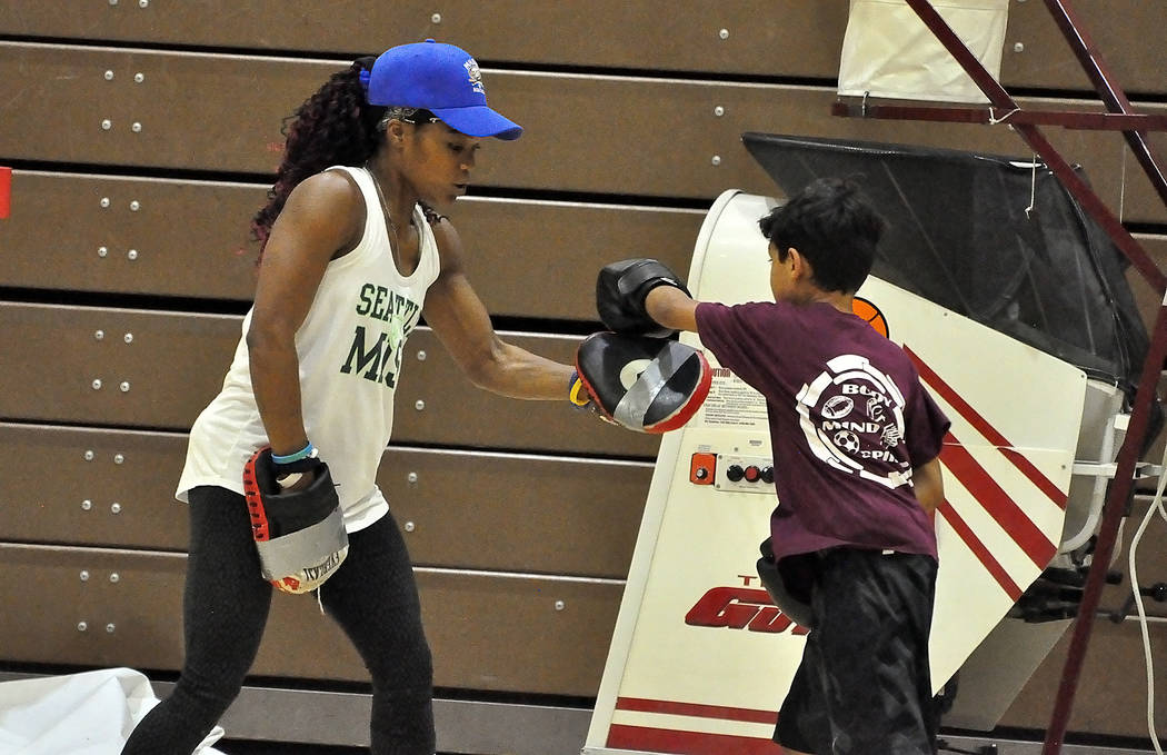 Sampson Wagner works on some skills with Maloy. What parents like about the clinic is Maloy is a good motivator and works well with all ages. They also like the fact that Maloy takes younger kids  ...