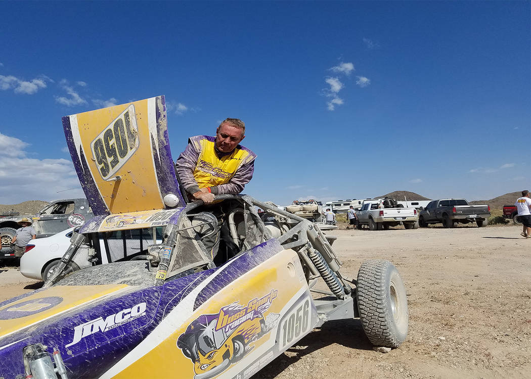 David Jacobs/Times-Bonanza & Goldfield News In this Aug. 19 photo, racer Johnny Buss, part owner of the Los Angeles Lakers, checks out his vehicle as he prepares to exit it after arriving in T ...