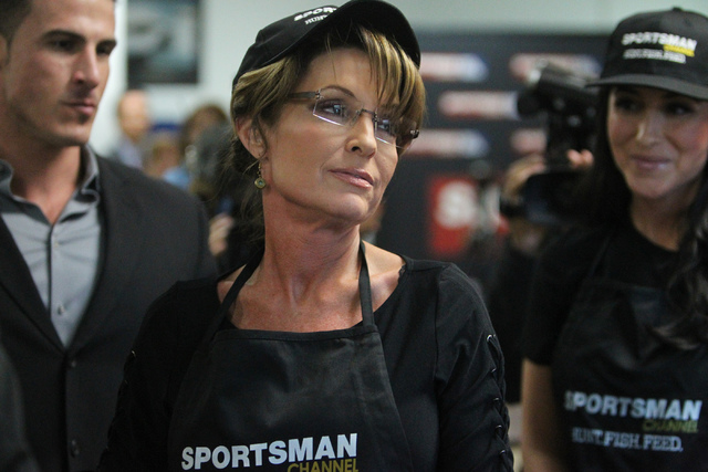 Erik Verduzco/Las Vegas Review-Journal Former governor of Alaska Sarah Palin is photographed before serving food to people at the Salvation Army in North Las Vegas, Thursday, Jan. 22, 2015. The ev ...