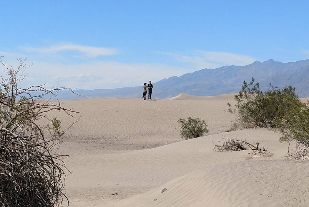 Mark Davis/Las Vegas Review-Journal Visitors hike up the Mesquite Flat Sand Dunes at Death Valley National Park in California on Monday, June 12, 2017.