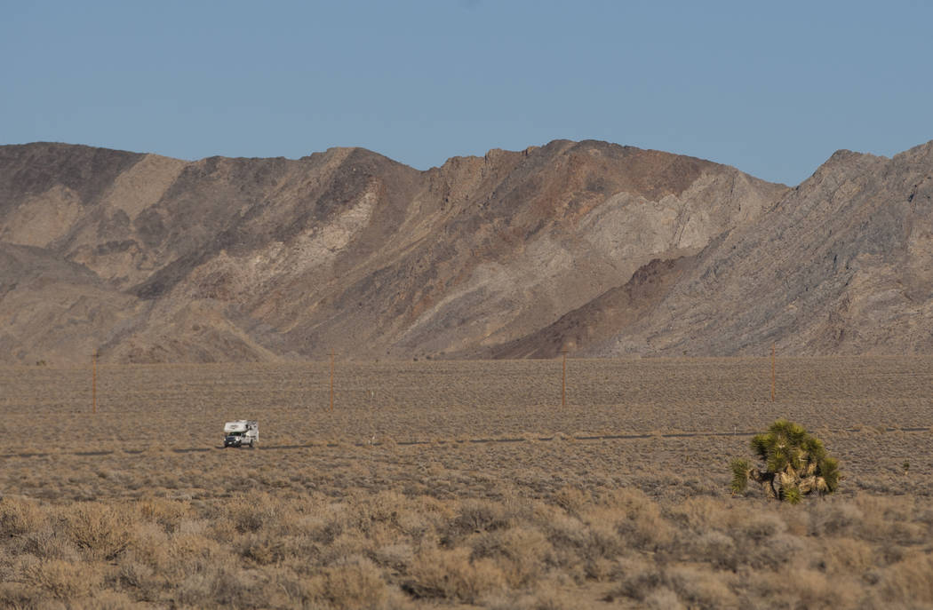 Chase Stevens/Las Vegas Review-Journal An RV drives along California State Route 190 outside of Death Valley National Park, seen from the area of the remains of the tree featured in the album artw ...