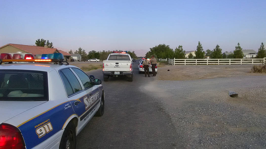 Selwyn Harris/Pahrump Valley Times Nye County Sheriff's Deputies responded to the 2800 block of Deerskin after a neighbor claimed a man walked onto his property and fired a shot in the air. The su ...