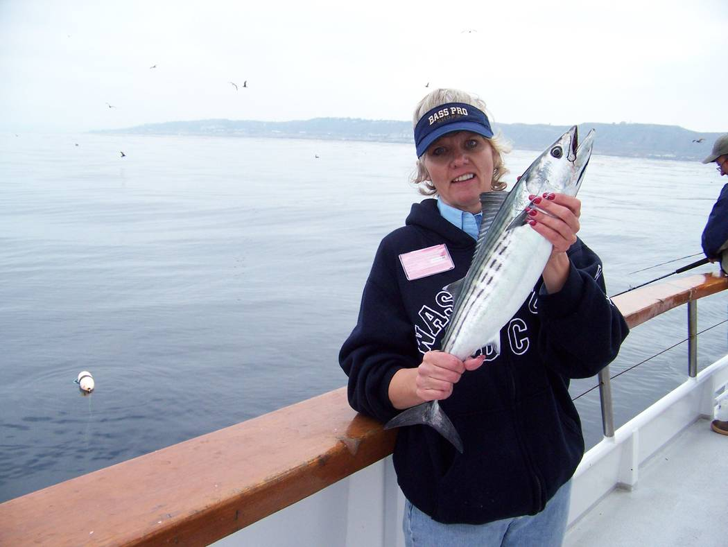 Dan Simmons Laura Oslund, once an administrator for the Nye Communities Coalition, has a successful fishing adventure in Point Loma, California. Now director of the coalition's sister organization ...