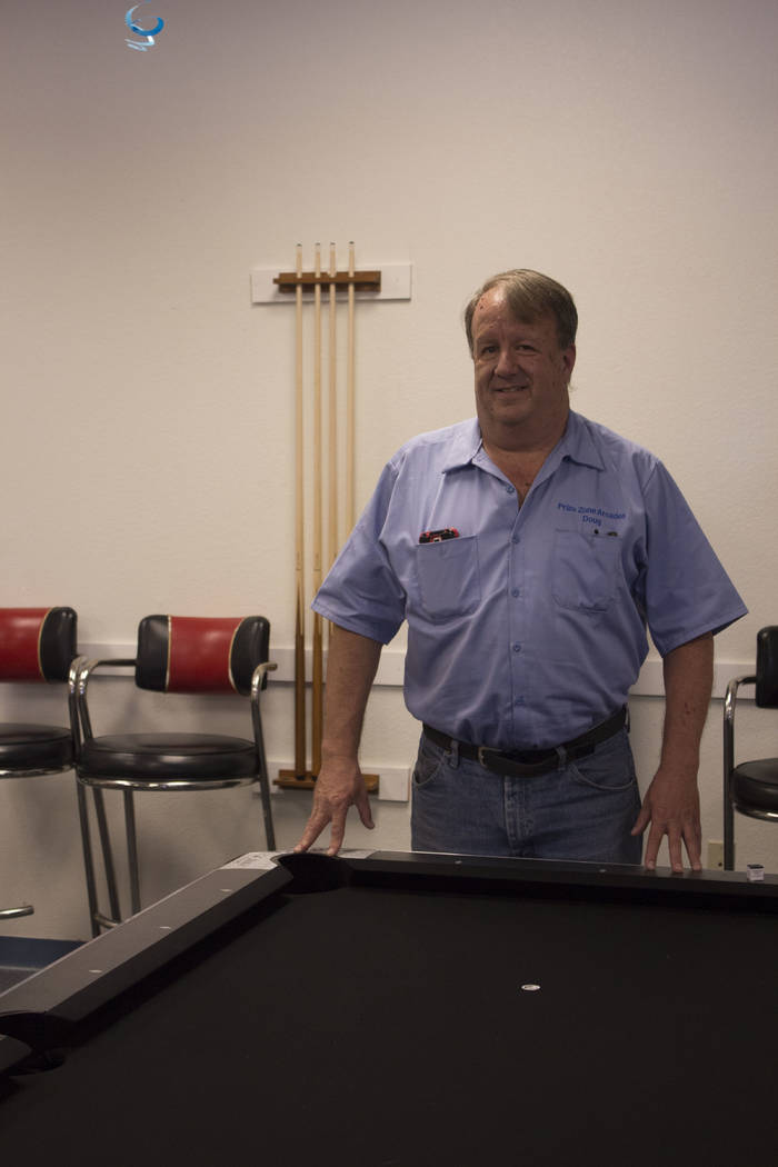 Jeffrey Meehan/Pahrump Valley Times Doug Bale, owner of Prize Zone Arcade, stands at one of his two pool tables at 1330 S. Highway 160 on July 27, 2017. Eight-pool tournaments are available for ki ...