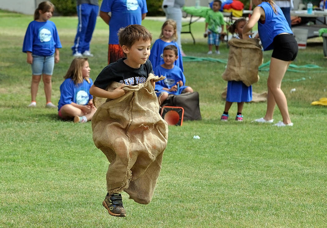 Horace Langford Jr./Pahrump Valley Times - About 30 kids came out for this year's games, which were held in Petrack Park. The program makes its rounds through the county and over 300 kids particip ...