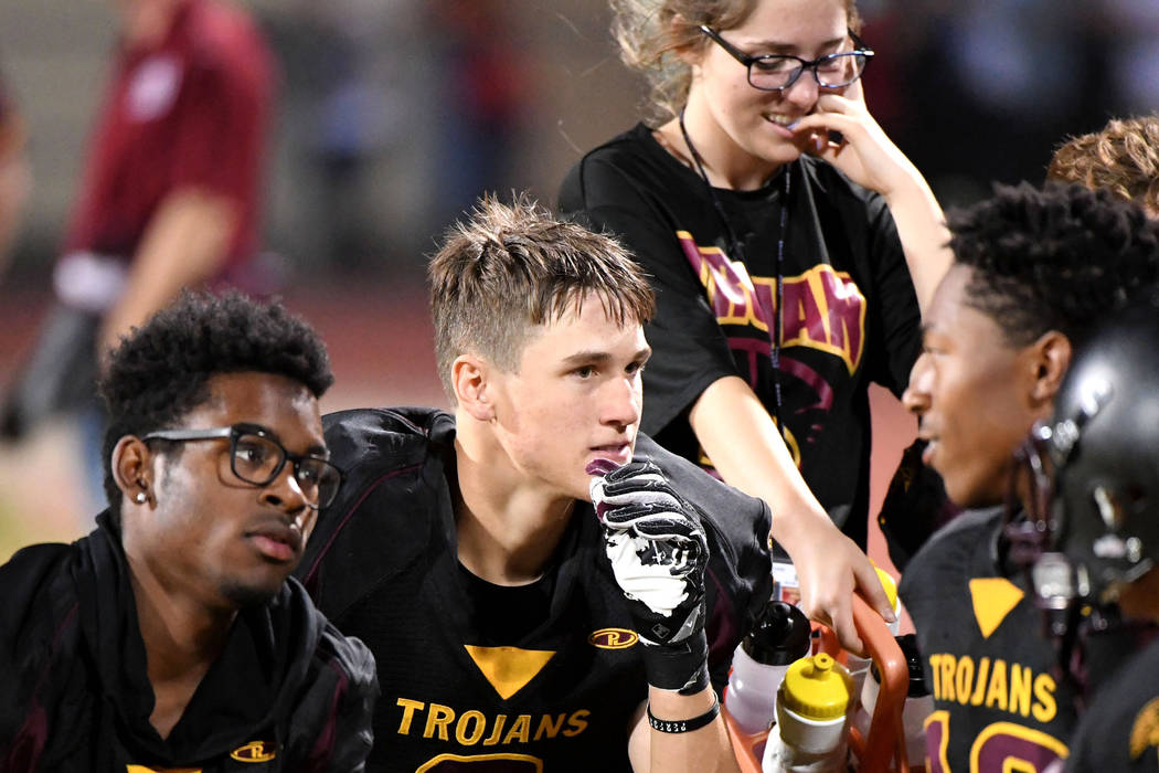 """Peter Davis/Special to the Pahrump Valley Times  Cory Bergan is known as the """"heart"""" of the Trojans defense this year. He is seen taking a breather on the sideline against Western."""