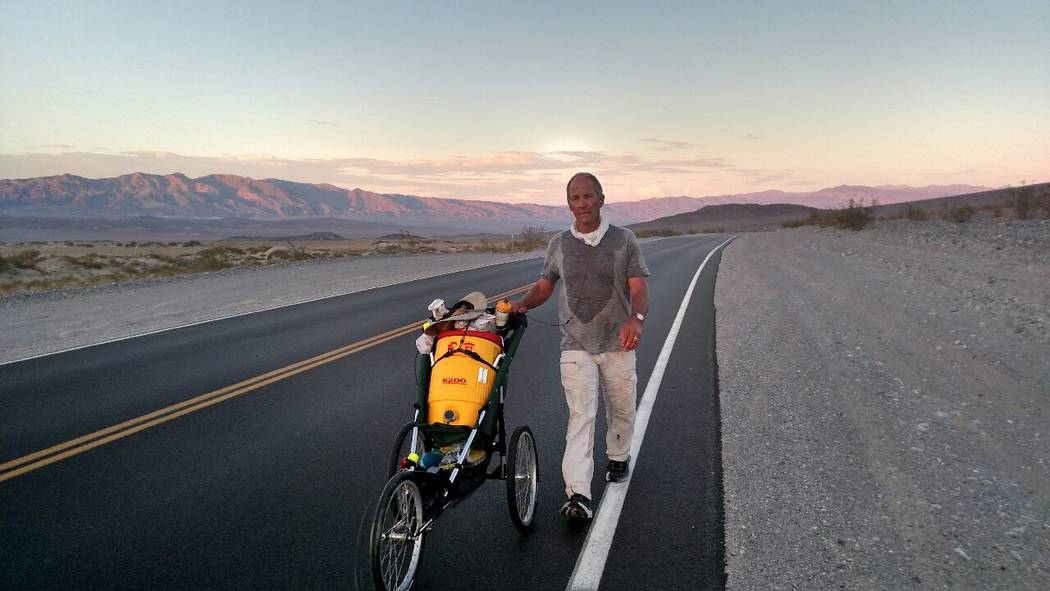 Heather Ulrich/Special to the Pahrump Valley Times  Marshall Ulrich pushes a jogger-baby stroller filled with six gallons of water in Death Valley. He said the temperature that day was 118 degrees ...