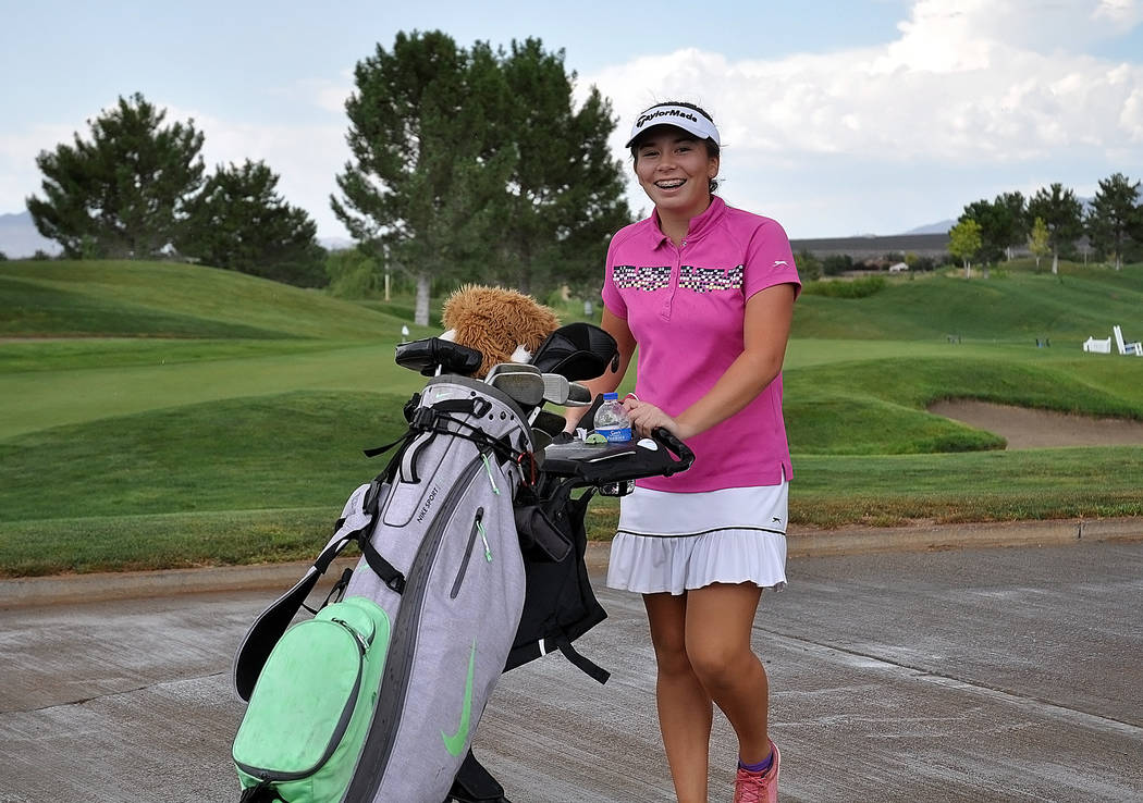 Breanne Nygaard is seen getting ready to resume the second day of golf after a one-hour delay. She took first place in the 15-18 division. She could be the top girls high school player this year.