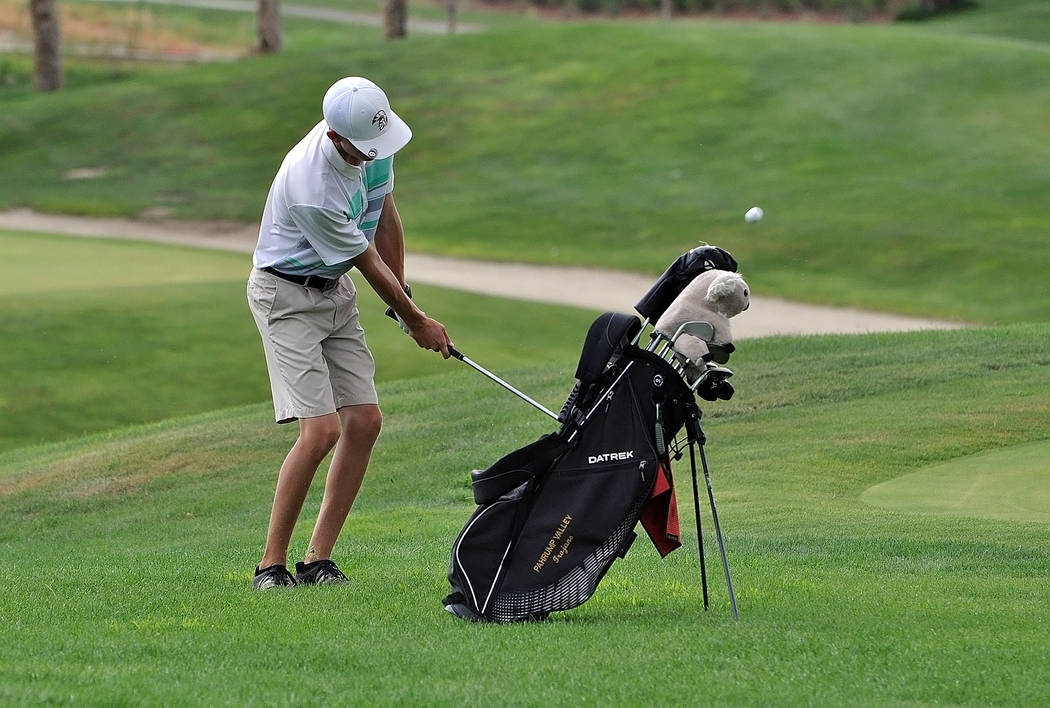 Austen Ancell chips the ball onto the green on the second day of the tourney after the one-hour rain delay on Wednesday. Ancell finished the tournament with a 12-under-par 132, which was his best  ...