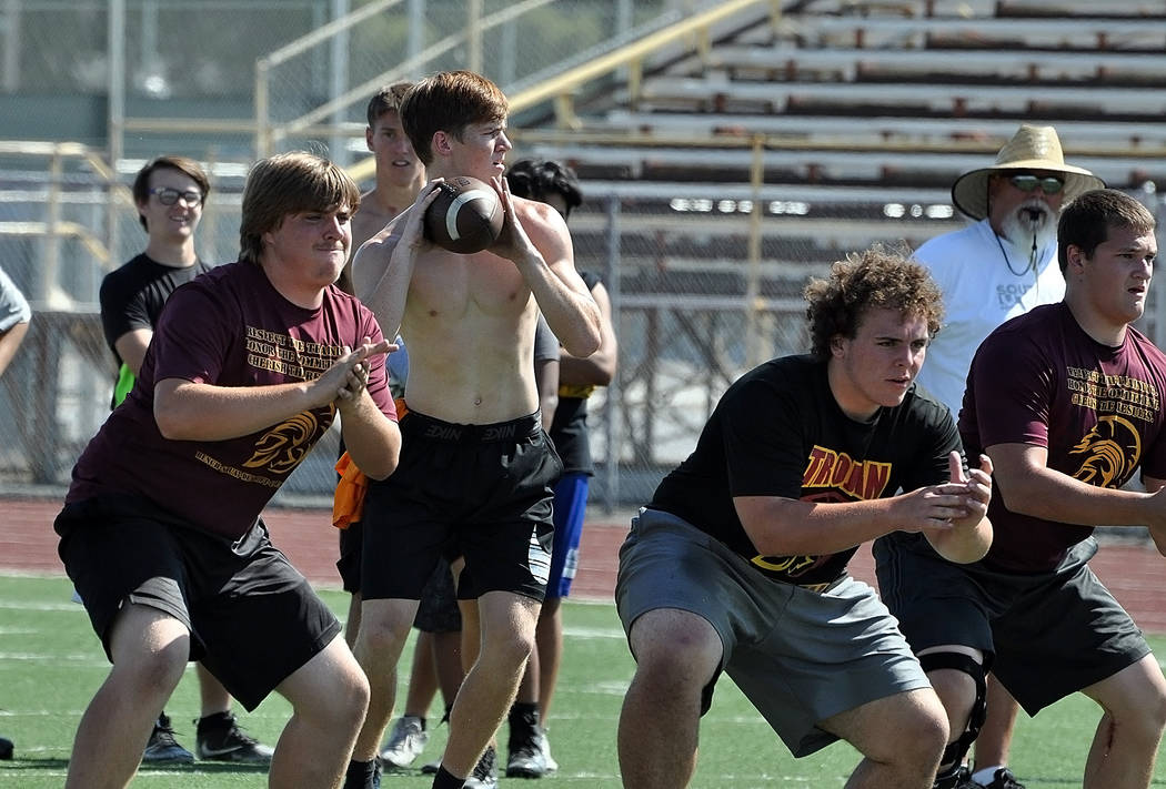 Horace Langford Jr./Pahrump Valley Times Quarterback Dylan Coffman is seen during the first week of Trojans football practice last week, throwing the ball. Trojans coach Joe Clayton likes the mobi ...