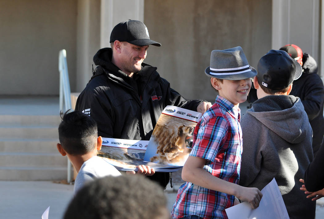 Horace Langford Jr. / Pahrump Valley Times  Jason Coleman hands out posters to the kids at Rosemary Clarke Middle school last year in December just before the Pahrump 250. This year Coleman will m ...