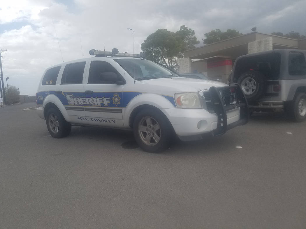 David Jacobs/Pahrump Valley Times  The search continues for the man suspected of robbing Bank of America just before 3 p.m. on Friday August 4. The unidentified white male adult clad in an orange  ...