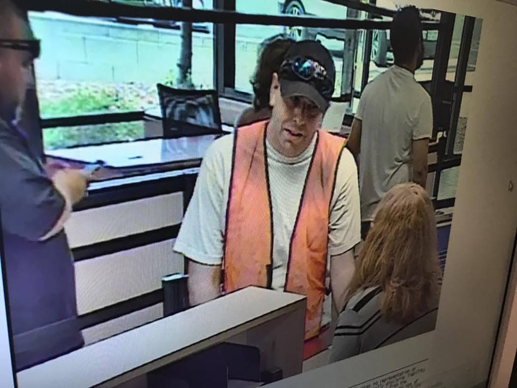 Special to the Pahrump Valley Times  A surveillance still photograph of the robbery was captured of the bank robbery suspect standing before a teller, as several customers were conducting business ...