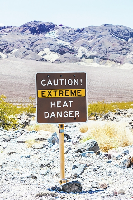 A road sign in Death Valley warning travelers of Caution Extreme Heat Danger