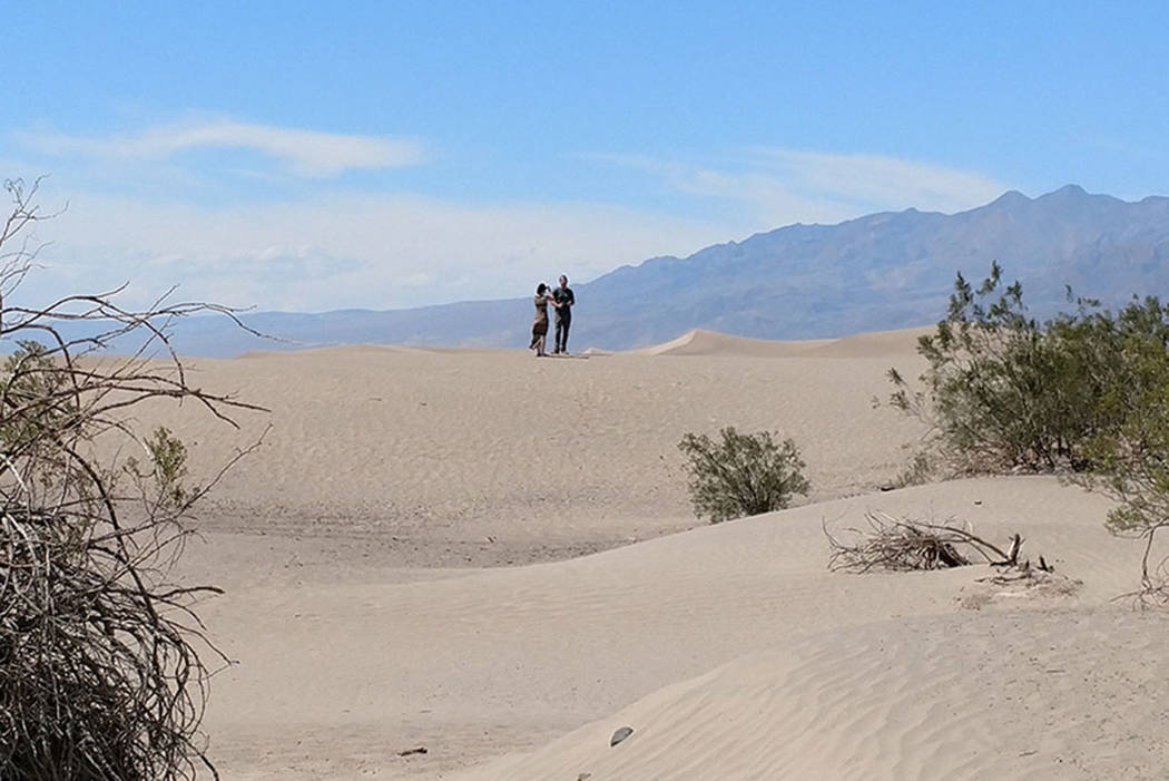 Visitors hike up the Mesquite Flat Sand Dunes at Death Valley National Park in California in summer 2017. (Mark Davis/Las Vegas Review-Journal)