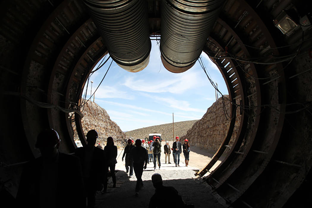 Sam Morris/Las Vegas Review-Journal Members of a congressional tour of the Yucca Mountain exploratory tunnel enter the south portal, April 9, 2015.  Last week, U.S. Sens. Dean Heller, R-Nevada and ...