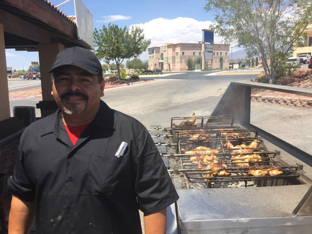Jeffrey Meehan/Pahrump Valley Times  Gonzalo Contreras, owner of the newly opened El Pollo Ranchero, stands in front of his grill filled with ribs and chicken on July 29, 2017. Motorists and peopl ...