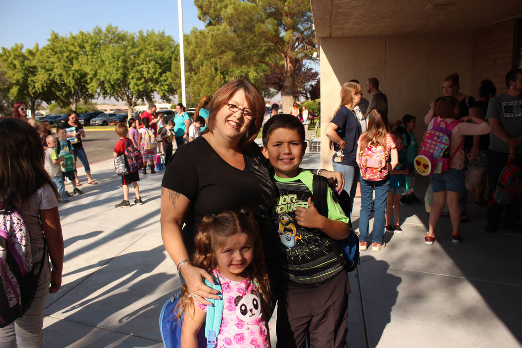 Jeffrey Meehan/Pahrump Valley Times Charlotte Hernandez, mother of a fourth grader, Roman and first grader, Izza' Bella, wait for the doors to open at J.G. Elementary School on Aug. 7. That was th ...