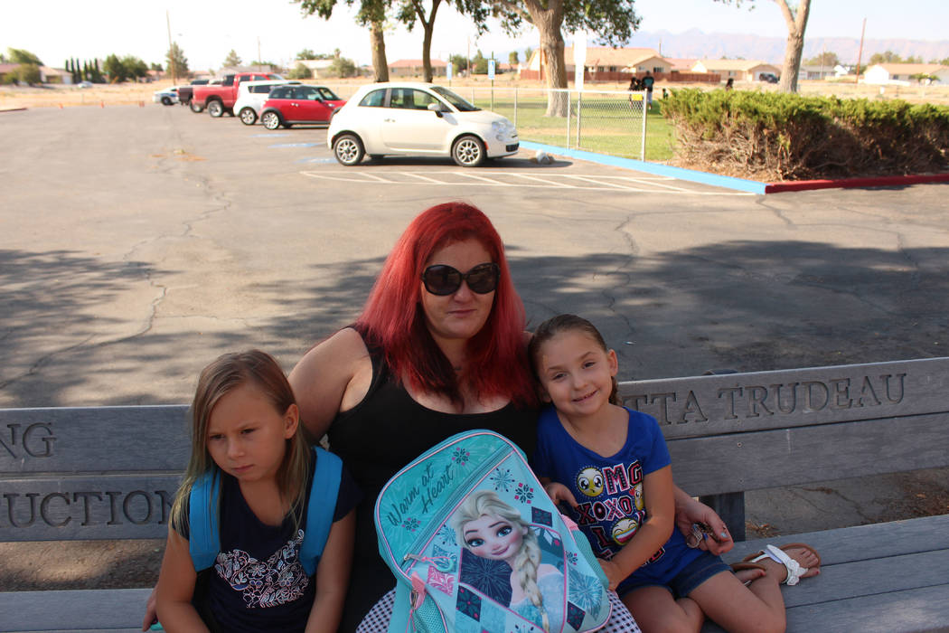 Jeffrey Meehan/Pahrump Valley Times  Christina Pipkins (center), mother of a first grader, Cerenity, (right) on Aug. 7, the first day of instruction for most kids in Nye County. Kindergarteners an ...