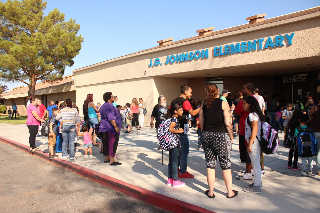 Jeffrey Meehan/Pahrump Valley Times Several parents wait for the doors to open at J.G. Johnson Elementary School in Pahrump on Aug. 7. Instruction begins at 9:05 a.m. instead of 8 a.m. for daily m ...