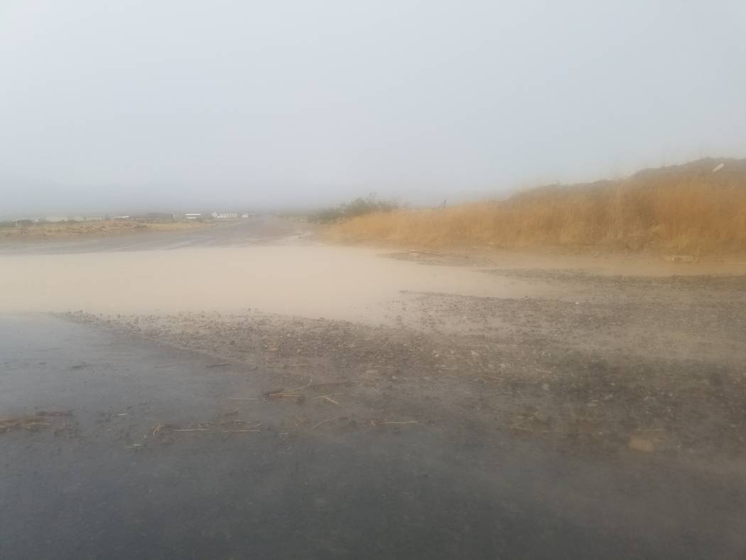 Standing water at Bell Vista Road and Highway 160 in Pahrump. Several local streets were damaged during the afternoon storm on Aug. 4, with road crews working on them into next week.