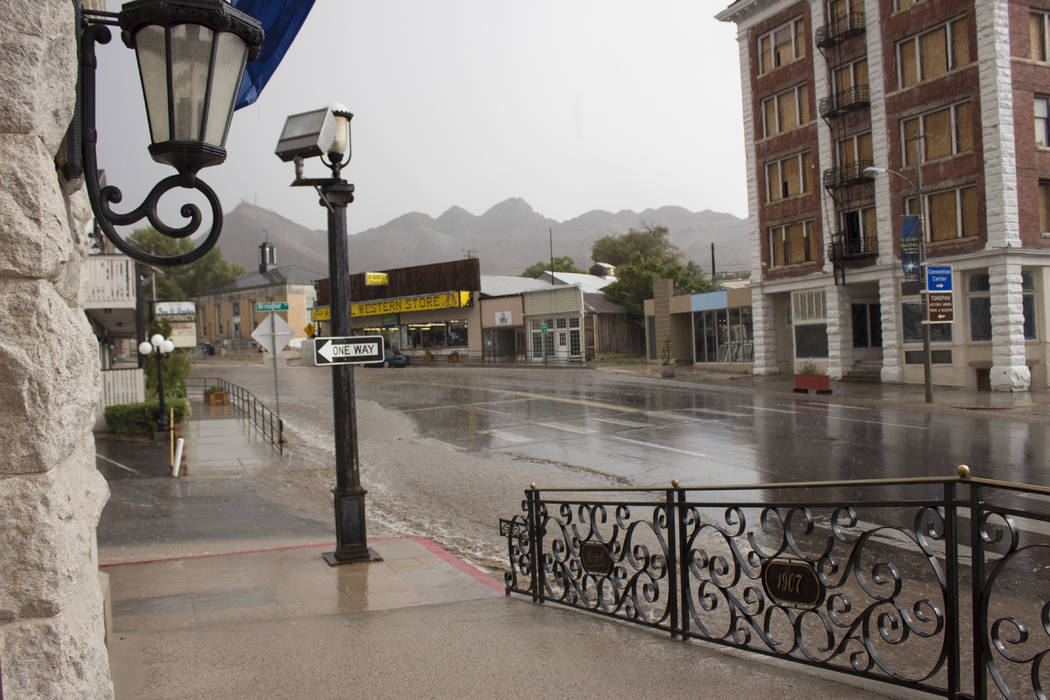 Jeffrey Meehan/Pahrump Valley Times Flood waters build up on U.S. Highway 95 in Tonopah in front of the Mizpah Hotel on Aug. 4.